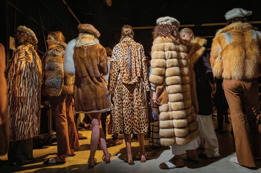 Models prepare to show fur coats and hats by designer Simonetta Ravizza.